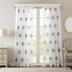 Delicate and sophisticated, our Bombay Massa window panel will soften any room for a simple and elegant update. Lightweight sheer fabric features beautiful embroidered medallions in dark grey, creating contrast for an updated look. Hang on rod pocket or back tabs for a tailored look, fits up to 1.25
