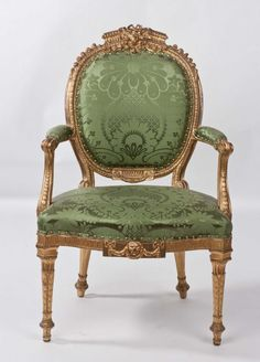 One of a set of eighteen George III giltwood open armchairs at Harewood House by Thomas Chippendale.