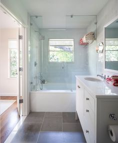 Large grey tiles, done without being too modern. Master bath inspiration.