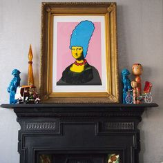 Prop up some art. Play with the traditional idea of hanging a mirror or painting above your mantelpiece; prop an artwork on it instead. It helps if the artwork itself is an irreverent rethink of a celebrated piece — in this case the Mona Lisa got the Marge Simpson treatment!