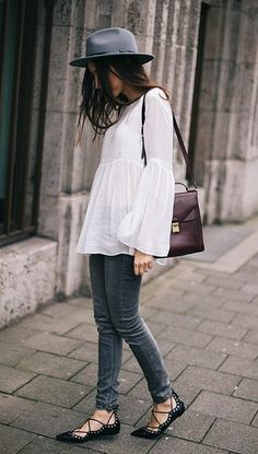 A White Bell-Sleeve Top, Skinny Jeans, Lace-Up Flats, and a Fedora