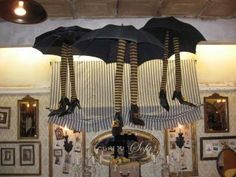Witches hanging from the ceiling. Love their umbrella skirts!
