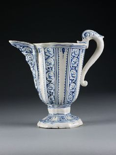 Ewer, fluted, tin-glazed earthenware painted with leafy scrollwork in reserve on a blue ground, made in Faenza, Italy, 1560-70 | V&A Search the Collections