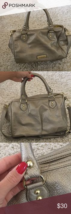 Steve Madden gold handbag with strap In GUC. Slight wear on the handles. Really pretty gold almost champagne color. Can be worn as crossbody Steve Madden Bags Crossbody Bags