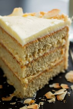 NYT Cooking: This impressive and wonderfully moist layer cake is less sweet than the usual coconut affair, thanks to a tangy cream cheese frosting on top and dose of orange juice in the batter. Desserts To Make, Great Desserts, Köstliche Desserts, Delicious Desserts, Food To Make, Dessert Recipes, Tropical Desserts, Easter Desserts, Cakes By Melissa