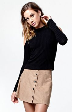 "Kendall & Kylie present a fall wardrobe essential with the Faux Suede Button Front Skirt. Available in two solid hues, this skirt features a soft, faux suede construction, flowy fit, plus a charming button front closure. Try styling this look with our cropped sweaters or tees.   	High-waisted skirt 	Snap button front closure 	Faux suede fabric 	Model is wearing a size small 	Model's measurements: Height: 5'9"" Bust: 34"" Waist: 24"" Hips: 34"" 	92% polyester, 8% spa..."