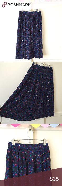 """Retro 80s Geometric Midi Skirt This is the rad 80s midi skirt you've been looking for! Quality made by Pendleton with bright geometric shapes on the black background. I'd keep it but my curves are too fly!  Vintage Size 8  Approximate measurements:  Waist: 26-31""""  Length: 27"""" Pendleton Skirts Midi"""