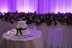 Purple floral bridal table hedge with purple lit backdrop. Styled by Greenstone Events.