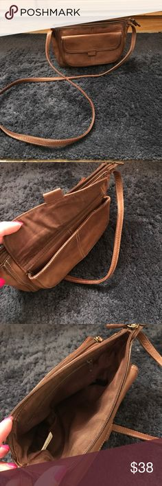 "Fossil crossbody organizer bag Vintage Fossil bag. 9""  x 6"" x 3"". Inside has a zip pocket. Outside has a magnetic closure pocket on one side and a double zip organizer on the other.  Organizer holds 6 cards and has a cash slot and a zip pocket. Dark brown. Some darkening of the leather. Fossil Bags Crossbody Bags"