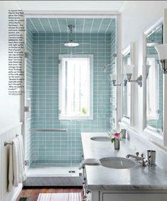 glass door over width of shower in narrow bathroom