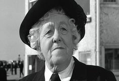Dame Margaret Rutherford.  I love her!   http://www.movieactors.com/photos-stars/margaret-rutherford-murderahoy7.jpg