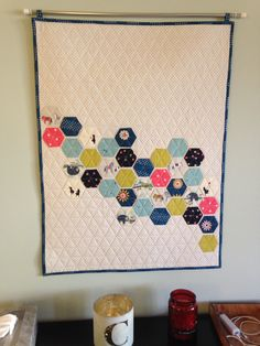 Modern hexie wall quilt with Cotton and Steel fabrics sewn with Bethany