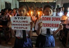 School children in Agartala, India, hold candles and placards as they pray during a June 29 vigil to show solidarity with the victims of the suicide attack at Istanbul's Ataturk Airport. The June 28 bombings killed dozens and wounded more than 200 as Turkish officials blamed the carnage at the international terminal on three suspected Islamic State group militants. (CNS photo/Jayanta Dey, Reuters)