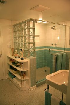 blue tile bathroom - vintage style - from scratch! Walk in shower with corner bench. See Retro Renovation for detail.Walk in shower with corner bench. See Retro Renovation for detail. Glass Block Shower, Casa Retro, Mid Century Bathroom, Art Deco Bathroom, Bathroom Ideas, Bathroom Showers, Basement Bathroom, Bathroom Shelves, Retro Renovation