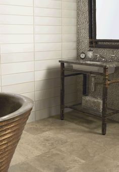 "ANN SACKS Amativo 16"" x 16"" marble field in brushed finish with koi 5-3/4"" x 19-3/4"" ceramic field in sharkskin on left wall, conrad vanity in black bamboo and kuo wavelet bath in copper"
