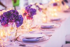 Dinner party table with bunches of bright purple hydrangeas