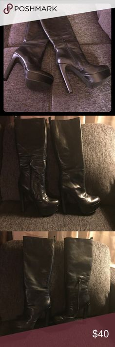 Classy and stylish black knee high boots Sleek black leather upper knee high platform Jessica Simpson boots. Half zip on the inside of each leg. Approximately 4 inch heel and 2 inch platform. Normal wear but good condition no rips, tears or scratches. Jessica Simpson Shoes Heeled Boots