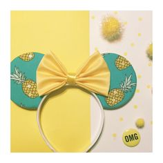 Blue Pineapple Mouse Ears   + Blue, with pineapple printed fabric fabric, front & back  + Yellow sequins randomly on the pineapples and a yellow