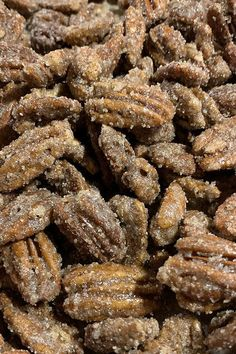 Christmas and Thanksgiving aren't complete without baking candied pecans! Make this delicious and easy nut recipe by tossing pecans in a mixture of sugar, cinnamon, and salt. Serve these candied nuts as a snack or appetizer at a holiday party or give them as a gift to friends and family!