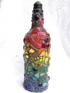 Rainbow Mosaic Bottle glue all the glass nuggets on with transparent glue then grout with any color grout Empty Wine Bottles, Bottles And Jars, Glass Bottles, Recycle Bottles, Bottle Candles, Mosaic Art, Mosaic Glass, Glass Art, Mosaic Mirrors