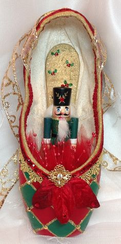 Red and Green Nutcracker themed pointe shoe. by DesignsEnPointe Pointe Shoes, Ballet Shoes, Dance Shoes, Harlequin Pattern, Nutcrackers, Nutcracker Christmas, Centre Pieces, Pretty Shoes, Dance Costumes