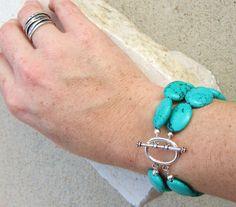 Chunky Turquoise Bracelet.Turquoise Howlite Double Strand Bracelet. Toggle Bracelet. Turquoise Jewelry. $18.00, via Etsy.