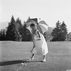 Yes it IS possible to be active in a dress.  (Not sure exactly where the umbrella fits into the equation though...)  ~Audrey Hepburn