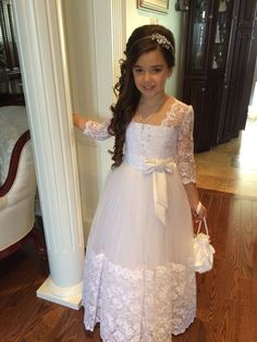 First Communion Dresses Carina - First Communion Dress with Lace Hem and Long Lace Sleeves - Vestidos para primera comunion - Kleid Girls First Communion Dresses, Holy Communion Dresses, Little Girl Dresses, Girls Dresses, First Communion Hair, Pageant Dresses, Party Dresses, Eid Dresses, Flower Girls