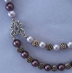 Purple beaded necklace - ****anything with open spaces can be used to attach another strand!***