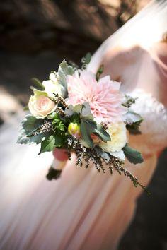 Café au lait dahlias, roses, calcinia, and dusty miller create an enchanting bouquet. Wedding Flowers: Seasonal Celebrations.