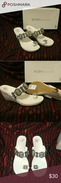 """BNIB 8.5 leather slide on sandals + toe ring slot BNIB. BCBGeneration's white leather slide on sandals w/toe ring style design. Has big grayish colored gems/stone (1.5""""H) w/silver hardware, & rectangle clear gems too. Wedge =.75"""" H Shoe maker added heel-savers for me. Non-slippery Rubbergrip bottom. ONLY flaw few (2) tiny gems are missing. Size of pen tip. Also have identical in black/silver too. Bought at Macy's paid $79. BCBGeneration Shoes Wedges"""