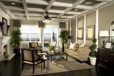 Living room design with glass doors to large patio.  Dark wood floor with brown rug sets the setting for the contemporary furniture, white a...