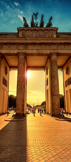 Brandenburg Gate, Berlin - Once marking the turbulent division of East and West Berlin, the Brandenburg Gate now stands at the head of a pedestrian plaza just blocks from the German parliament. Since the fall of the Berlin Wall, a physical and social reinvention has taken place throughout the city, visible in the bold lines of new architecture juxtaposing mementos of eras past