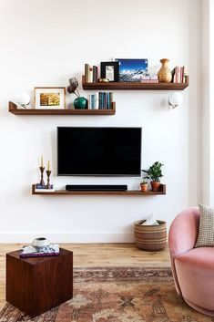 On the main wall in our living room, we added an easy DIY floating shelf with brackets. It was one of my favorite projects in our modern rustic living room makeover and is a major focal point in the room!… Continue Reading → Living Room Tv, Living Room Interior, Apartment Living, Tv Wall Ideas Living Room, Apartment Therapy, Apartment Ideas, Living Room Ideas Small Apartment, Decorating Living Room Shelves, Small Living Room Ideas With Tv