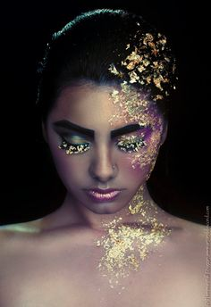 """""""Golden Child"""" is a photographic beauty print of a girl covered in gold leafing with shimmery makeup in purple, gold and teal colors.  Photographer: Theresa Wall Duggan/ Art and Discord Studios Model: Isabella Capri Makeup and Hair: Lyndsay Simon/ Makeup by Lyndsay  Prints for sale on Etsy:  https://www.etsy.com/listing/170828481/fine-art-photography-print-golden-child?ref=listing-shop-header-3"""