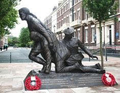 Abercromby Square is to become the permanent home for the Liverpool Heroes Memorial which commemorates Captain Noel Chavasse VC & Bar MC, the only man to be twice awarded the military's highest award for valour, the Victoria Cross, in WWI & 15 other Liverpool-born Victoria Cross recipients.  Designed by local sculptor, Tom Murphy, the bronze statue depicts Captain Chavasse and a Liverpool Scottish stretcher bearer attending a wounded soldier and is referred to locally as the 'Chavasse…