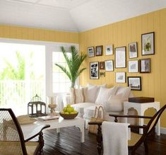 Living Room:Breathtaking Yellow Wall Colors Living Room With White Leather Sofa And Square White Coffee Table On Dark Wooden Floor Also Relaxing Rattan Armchair Decor Idea Interesting Yellow Paint Color Schemes for Living Room