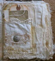 Fabric & lace book with pockets to fill with old photos & memorabilia by Lilla LeVine at justlilla.blogspot.com