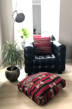 Moroccan Kilim pouf made from vintage kilim rugs.  60 x 60 x 20 cm/ 24 x 24 x 8 inch.  100% wool and handmade.  Each pouf is Unique, with only one available.