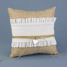Natural burlap ring pillow with white, gathered cloth layer, twine, and silver-tone heart.  A special job calls for special gear! A variety of styles and designs are available, making it easy to find the perfect Ring Pillow to accessorize any wedding theme.  #wedding favors, #bridal shower favors, #party favors, #personalized favors, #decorations, #bridesmaids gifts, #bridal party gifts, #wedding supplies, #timelesstreasure