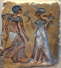 Tutankhamun with his wife Ankhesenamun. She is giving him lotus flowers to scent. Note the stick on which the young pharaoh Tutankhamun is leaning on. His back was disformed by skolios or Klippel-Feils syndrome, which made walking very difficult for the young boy. Walk in the Garden; Relief on limestone. Neues Museum, Berlin