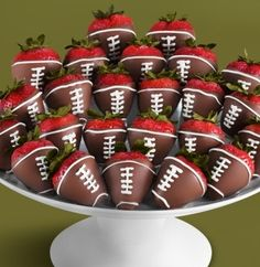 Chocolate dripped strawberries with a football design.  How cute are these?!?!