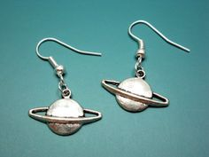 Adorable Saturn planet earrings The charms on the earrings are 20x13.5mm and are lead and nickel free zinc alloy.