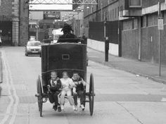 Dublins city kids scutting on the back of any vehicle