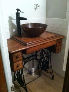 This is a sewing machine table from We took out the machine, added the pipes, bowl and faucet, and now I have a unique bathroom sink/ vanity combination. - my mom has a sewing machine just like this! Unique Bathroom Sinks, Bathroom Sink Design, Bathroom Sink Vanity, Sink Faucets, Bathroom Layout, Bathroom Pink, Bowl Sink Vanity, Vessel Sink, Bathroom Ideas