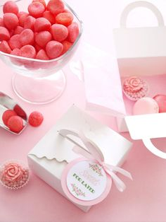 Give your guests small patisserie boxes for takeaway cake or midnight treats. Embellish each box with a sweet printable tag and ribbon to match. Don't forget to provide candy scoops so guests can help themselves.