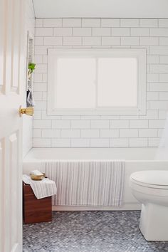 White on white subway tile and penny tile -- Before & After: Christinas New Neutral Bathroom Mosaic Bathroom, Bathroom Floor Tiles, Shower Floor, Bathroom Renos, Bathroom Wall, Shower Bathroom, Kitchen Tiles, Bathroom Ideas, Tiled Bathrooms