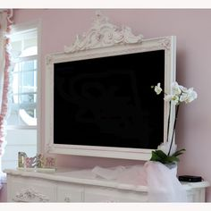 Petite Paris TV Frame - K, I'd like to do something like this for your TV on my next visit. Maybe white or coral colored, but it will be on the actual tv so you can still move it around and stuff. :)
