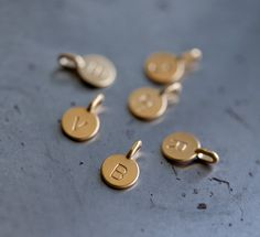 This listing is for a Gold Vermeil Tiny Initial Charm. These adorable charms make great personalized gifts! Each vermeil charm is stamped with an Disc Necklace, Initial Necklace, Necklaces, Tiny Gifts, Initial Charm, Monogram Gifts, Personalized Jewelry, Solid Gold, Initials