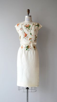 Vintage late 1950s, early 1960s ivory silk dress that presents like a two-piece…